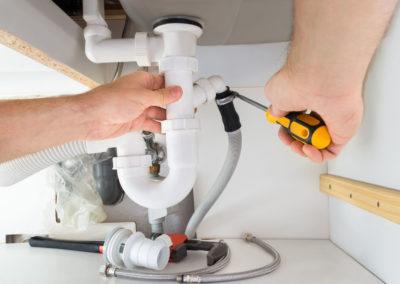 35943634 - close-up of a male plumber repairing sink in bathroom